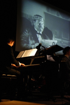Improvising over early silent movies. Waller Jeffs (on screen). 1900-1910. The Flat Pack Festival 2009 featured The Great Train Robbery original composition by Martin Riley performed by the band The Destroyers conducted by the composer.